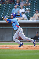 Pin-Chieh Chen (7) of the Tennessee Smokies follows through on his swing against the Birmingham Barons at Regions Field on May 3, 2015 in Birmingham, Alabama.  The Smokies defeated the Barons 3-0.  (Brian Westerholt/Four Seam Images)