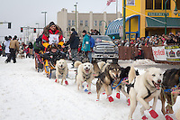 Mitch Seavey and team leave the ceremonial start line at 4th Avenue and D street in downtown Anchorage during the 2013 Iditarod race. Photo by Jim R. Kohl/IditarodPhotos.com