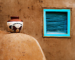 Turquoise window on an adobe structure at Taos Pueblo, New Mexico