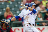 Round Rock Express first baseman Carlos Pena (33) follows through on his swing during the Pacific Coast League baseball game against the Oklahoma City RedHawks on August 1, 2014 at the Dell Diamond in Round Rock, Texas. The Express defeated the RedHawks 6-5. (Andrew Woolley/Four Seam Images)