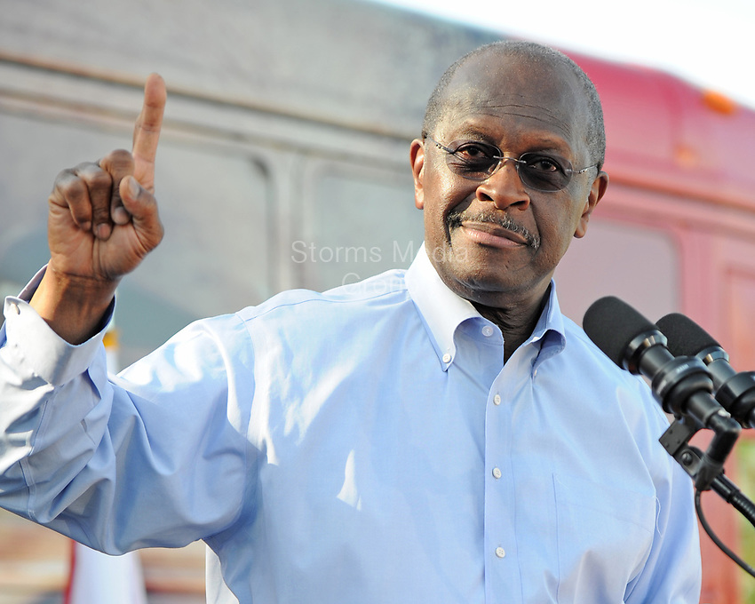 CORAL SPRINGS, FL - NOVEMBER 16: Republican Presidential candidate Herman Cain speaks during a campaign rally outside of Wings Plus on November 16, 2011 in Coral Springs, Florida. Cain was in South Florida on a campaign swing<br /> <br /> <br /> People:  Herman Cain
