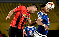 BOGOTA - COLOMBIA – 17 - 04 - 2018: Ayron del Valle (Der.) jugador de Millonarios (COL), salta por el balon con Henri Pernia (Izq.) jugador de Deportivo Lara (VEN), durante partido entre Millonarios (COL) y Deportivo Lara (VEN), durante partido entre Millonarios (COL) y Deportivo Lara (VEN), de la fase de grupos, grupo G, fecha 3 de la Copa Conmebol Libertadores 2018, en el estadio Nemesio Camacho El Campin, de la ciudad de Bogota. / Ayron del Valle (R) player of Millonarios (COL), jumps for the ball with Henri Pernia (L) player of Deportivo Lara (VEN), during a match between Millonarios (COL) and Deportivo Lara (VEN), of the group stage, group G, 3rd date for the Conmebol Copa Libertadores 2018 in the Nemesio Camacho El Campin stadium in Bogota city. VizzorImage / Luis Ramirez / Staff.