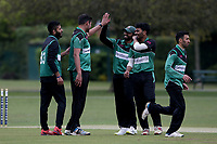 Harsh Kumar of Ilford celebrates with his team mates after taking the wicket of Tom Daniels during Upminster CC (batting) vs Ilford CC, Hamro Foundation Essex League Cricket at Upminster Park on 8th May 2021