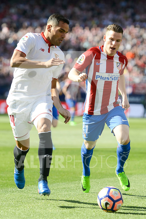 Atletico de Madrid's Kevin Gameiro and Sevilla's Gabriel Mercado during La Liga match between Atletico de Madrid and Sevilla CF at Vicente Calderon Stadium in Madrid, Spain. March 19, 2017. (ALTERPHOTOS/BorjaB.Hojas)