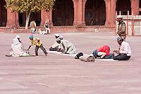 Fatehpur Sikri, Uttar Pradesh, India.  Men Praying in the Courtyard of the Jama Masjid (Dargah Mosque).