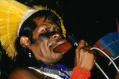 Altamira, Brazil. Kayapo Chief Raoni using a microphone at the conference to stop hydroelectric dams.