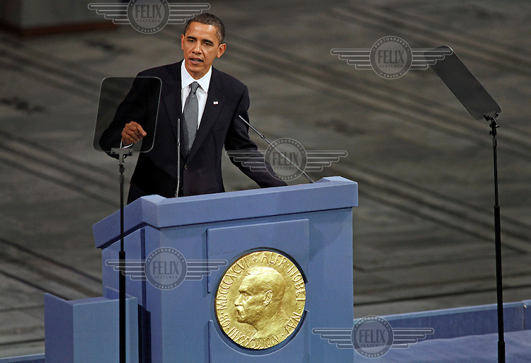 (Dec 10,2009 Oslo,Norway) US President Barack Obama received the Nobel Peace Prize during a ceremony in Oslo Town Hall. The prize was given to Obama by Nobel committee leader Thorbjørn Jagland. <br /> <br /> ©Fredrik Naumann/Felix Features.
