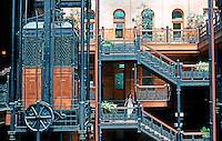 Los Angeles: Bradbury Building--Detmil, elevators. Cage elevator with wrought-iron grillwork.  Photo '78.
