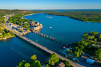 Aerial view of the FM 1431 Bridge and train trestle bridge on Lake LBJ in Kingsland, Texas. Surrounded by beautiful Texas Hill Country hills (including legendary Packsaddle Mountain) and embraced by the Llano River and Colorado River arms of constant-level Lake LBJ, Kingsland boasts miles of the Texas' most sought-after lakefront property.