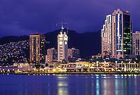 Aloha Tower at dusk, backed by Downtown Honolulu skyline