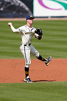 Shortstop Benjamin Sems (2) of the Michigan Wolverines throws out a runner in a game against the Purdue Boilermakers on Friday, March 12, 2021, at Fluor Field at the West End in Greenville, South Carolina. (Tom Priddy/Four Seam Images)