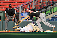 First baseman Brett Hash (27) of the Wofford Terriers reaches for a pickoff throw as Bryson Bowman (12) of the Western Carolina Catamounts scrambles to reach the bag in a SoCon Tournament game on Wednesday, May 25, 2016, at Fluor Field at the West End in Greenville, South Carolina. Western won, 10-9. (Tom Priddy/Four Seam Images)