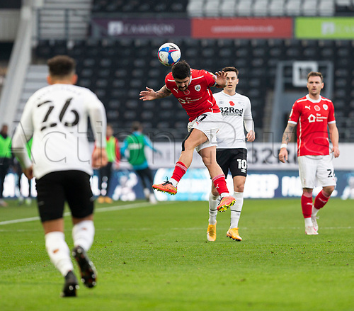 7th November 2020; Pride Park, Derby, East Midlands; English Football League Championship Football, Derby County versus Barnsley; Alex Mowatt of Barnsley jumps in the air to head the ball forward