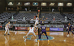 SIOUX FALLS, SD - MARCH 6: Stanley Umude #0 of the South Dakota Coyotes cups the opening tip against Tamell Pearson #2 of the Western Illinois Leathernecks during the Summit League Basketball Tournament at the Sanford Pentagon in Sioux Falls, SD. (Photo by Dave Eggen/Inertia)