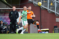 22nd August 2020; Tannadice Park, Dundee, Scotland; Scottish Premiership Football, Dundee United versus Celtic; Scott Brown of Celtic challenges for the ball with Nicky Clark of Dundee United