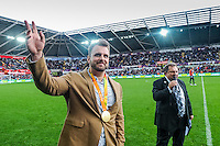 ( L-R )  Gold Medal winning palaolympian Aled Davies talks to Kev Johns during  half time of the Premier League match between Swansea City and Liverpool at The Liberty Stadium on October 1, 2016 in Swansea, Wales.