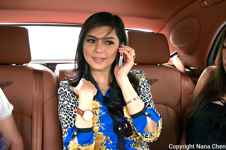 Former film actress and one of Vietnam's wealthiest women, Thuy Tien is the president of Imex Pan Pacific, a trading company that runs over 26 major businesses, including shopping malls, duty free fashion designer boutiques. Pictured here in her Bentley on the way to her high security riverside villa in Anphu, Saigon, a residential enclave with rich Vietnamese and expats.