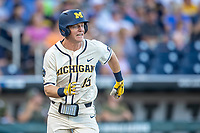 Michigan Wolverines first baseman Jimmy Kerr (15) runs to first base against the Vanderbilt Commodores during Game 1 of the NCAA College World Series Finals on June 24, 2019 at TD Ameritrade Park in Omaha, Nebraska. Michigan defeated Vanderbilt 7-4. (Andrew Woolley/Four Seam Images)