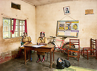 Cadet Assistant Superintendent of Prisons Geraldine Najjuma Prossy (L) and wardress Beatrice Ipali (R) in the visitor's room at Luzira Remand Prison. The facility was built to accommodate 600 inmates but it now has 1,300. Some prisoners have been on remand for many years.