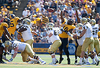 Kevin Prince (4) passes through the crowd. The California Golden Bears defeated the UCLA Bruins 35-7 at Memorial Stadium in Berkeley, California on October 9th, 2010.
