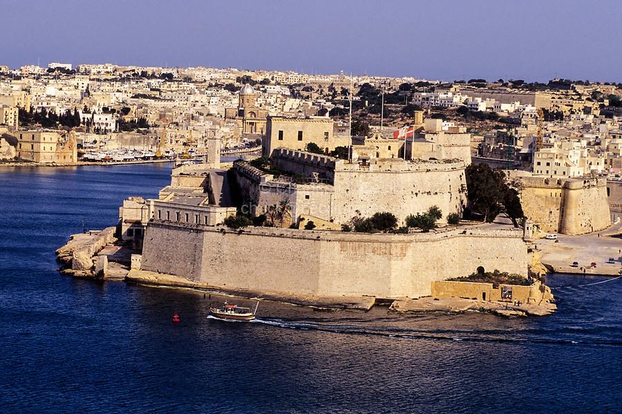 Vittoriosa, Malta.  Fort St. Angelo from Upper Barracca Gardens, Valletta.  Entrance to Kalkara Creek on left.