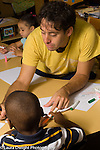 Preschool transition to start of school 3-4 year olds male teacher working with child