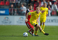 23 April 2011: Columbus Crew midfielder Kevin Burns #15 and Toronto FC forward Alan Gordon #21 in action during an MLS game between the Columbus Crew and the Toronto FC at BMO Field in Toronto, Ontario Canada..The game ended in a 1-1 draw.