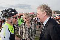 Universite Laval teacher Jean-Marie De Koninck and Quebec Premier Jean Charest as Quebec Minister of Transport Julie Boulet  looks on before the Ride in Silence event in Quebec City May 19, 2010. Ride in Silence is a worldwide event being held tonight to honor those injured or killed while cycling on public roads.<br /> <br /> PHOTO :  Francis Vachon - Agence Quebec Presse