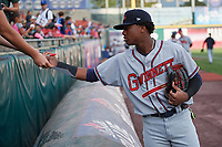 Gwinnett Braves left fielder Ronald Acuna (24) signs autographs before a game against the Buffalo Bisons on August 19, 2017 at Coca-Cola Field in Buffalo, New York.  Gwinnett defeated Buffalo 1-0.  (Mike Janes/Four Seam Images)