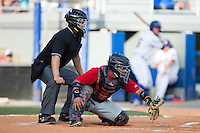 Elizabethton Twins catcher Rainis Silva (20) reaches for a low pitch as home plate umpire Garon Keuten looks on during the game against the Kingsport Mets at Hunter Wright Stadium on July 9, 2015 in Kingsport, Tennessee.  The Twins defeated the Mets 9-7 in 11 innings. (Brian Westerholt/Four Seam Images)