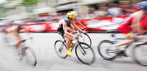 17 JUL 2011 - HAMBURG, GER - Competitors cycle through the spectator lined streets of Hamburg during the women's round of triathlon's ITU World Championship Series .(PHOTO (C) NIGEL FARROW)