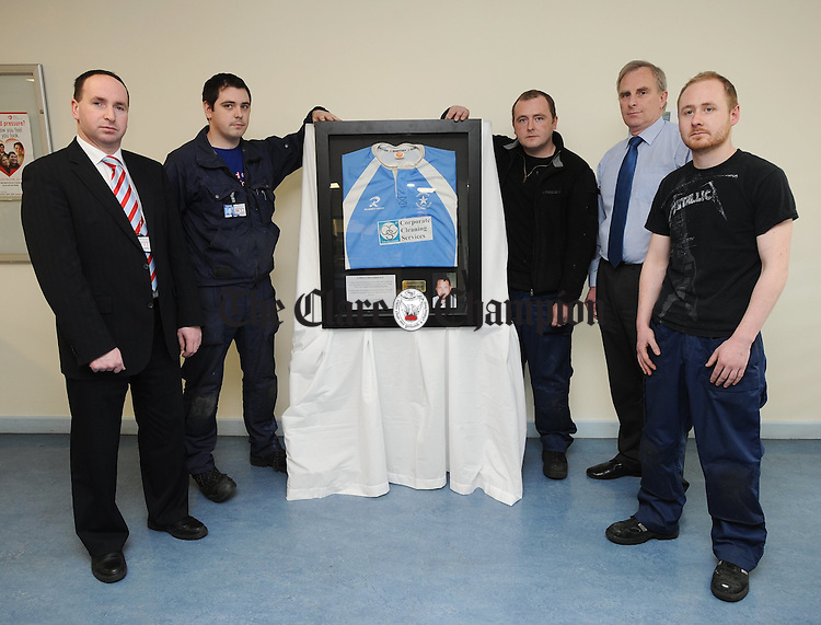 William Mc Gonagle, CEO Air Atlanta, Eamonn Cleary, Conor Madden, Kevin O Sullivan, Finance Director Air Atlanta, and Eoin Lewis with the wall memorial to Shane Geoghegan. Photograph by John Kelly.