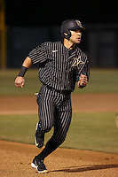 Zander Wiel (43) of the Vanderbilt Commodores runs the bases during a game against the UCLA Bruins at Jackie Robinson Stadium on March 06, 2015 in Los Angeles, California. Vanderbilt defeated UCLA, 6-0. (Larry Goren/Four Seam Images)