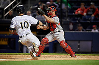 Pawtucket Red Sox catcher Dan Butler (12) waits for a throw as Dustin Fowler (10) slides in during a game against the Scranton/Wilkes-Barre RailRiders on May 15, 2017 at PNC Field in Moosic, Pennsylvania.  Scranton defeated Pawtucket 8-4.  (Mike Janes/Four Seam Images)