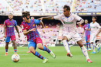 29th August 2021; Nou Camp, Barcelona, Spain; La Liga football league, FC Barcelona versus Getafe; Xavi and Sandro tussle for control of the ball