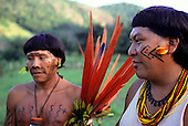 Roraima, Brazil. Davi Yanomami, spokesman for his people, and Levy with face, body paint and feather and bead decorations.