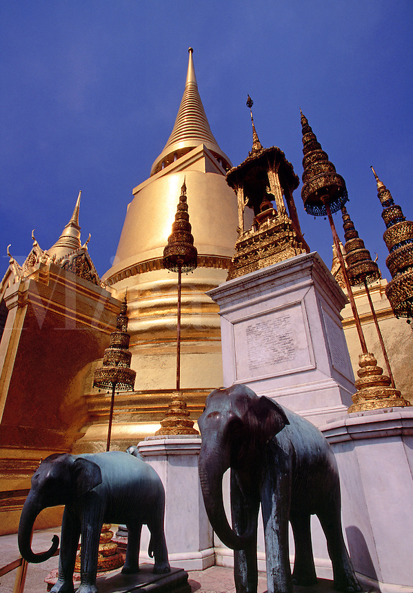 Elephant statues and golden chedi spire Wat Phra Keo Temple Bangkok Thailand.