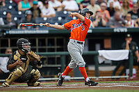 Cal State Fullerton Titans outfielder Tyler Stieb (3) follows through on his swing during the NCAA College baseball World Series against the Vanderbilt Commodores on June 14, 2015 at TD Ameritrade Park in Omaha, Nebraska. The Titans were leading 3-0 in the bottom of the sixth inning when the game was suspended by rain. (Andrew Woolley/Four Seam Images)