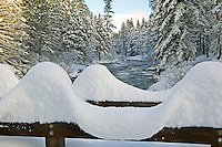 Snow pattern on rail of bridge at Wizard Falls Fish Hatchery. Metolius River, Oregon