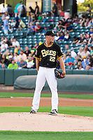Salt Lake Bees starting pitcher Drew Rucinski (22) looks home for the sign against the Tacoma Rainiers in Pacific Coast League action at Smith's Ballpark on August 31, 2015 in Salt Lake City, Utah.  Salt Lake defeated Tacoma 6-5. (Stephen Smith/Four Seam Images)