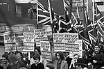 National Front march through Southwark South London 1980. Banner say Defend Our Old Folk Repatriate Muggers. 1980s UK