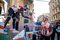 Jasper Stuyven (BEL/Trek-Segafredo) wins the 112th Milano-Sanremo 2021 (1.UWT) and offers the podium prosecco bottle to teammate/friend Ryan Mullen (IRE/Trek-Segafredo) at the podium ceremony<br /> <br /> 1 day race from Milan to Sanremo (299km)<br /> <br /> ©kramon
