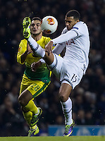 12.12.2013 London, England. Tottenham Hotspur midfielder Etienne Capoue (15) gets to the ball ahead of Anzhi Makhachkala forward Serder Serderov (28) during the Europa League game between Tottenham Hotspur and Anzhi Makhachkala from White Hart Lane.