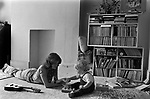 Mother and baby boy toddler playing games together. London 1975