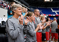Head coach Pia Sundhage and her staff listen to the introductions of the players before the game at Red Bull Arena in Harrison, NJ.  The USWNT defeated Mexico, 1-0.