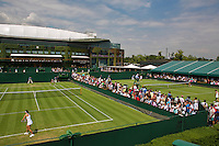 England, London, 23.06.2014. Tennis, Wimbledon, overall view outsite courts in the back Centercourt<br /> Photo:Tennisimages/Henk Koster