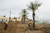 Djibouti. Tadjourah province. Tadjourah. Red sea on the gulf of Tadjourah. View from the car's windscreen on a rainy day. Black muslim woman walks on the dirt road.  © 2006 Didier Ruef