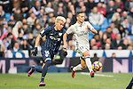 Lucas Vazquez (r) of Real Madrid competes for the ball with Adalberto Penaranda of Malaga CF during their La Liga 2016-17 match between Real Madrid and Malaga CF at the Estadio Santiago Bernabéu on 21 January 2017 in Madrid, Spain. Photo by Diego Gonzalez Souto / Power Sport Images