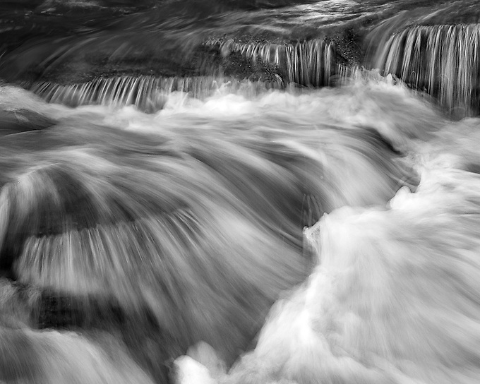 Dynamic flow during an incoming tide shot on a rugged stretch of the Atlantic Coast.