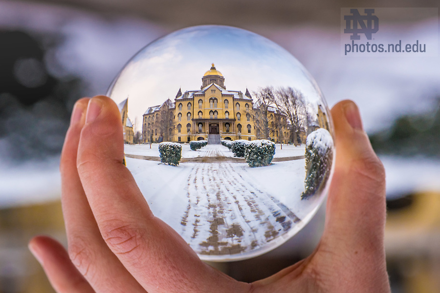 December 7, 2017; Main Building refracted in a crystal ball. 2 of 12 (Photo by Matt Cashore/University of Notre Dame)